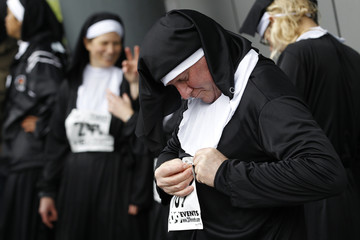 Runners dressed as nuns prepare to run in a charity event in London