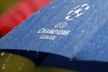 General view of an umbrella with Champions League logo during training