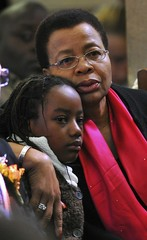 Graca Machel, wife of former South African President Nelson Mandela, comforts one of her great grandchildren at the memorial of Zenani Mandela at the St Stithians College Chapel in Sandton