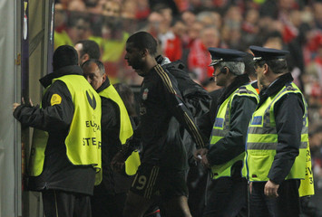 Babel of Liverpool walks out of the pitch after receiving a red card during their Europa League quarter-final, first leg soccer match at Luz stadium in Lisbon
