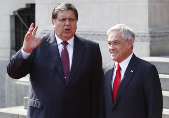 Chile's President Pinera and his Peruvian counterpart Garcia talk upon his arrival at the Government Palace in Lima