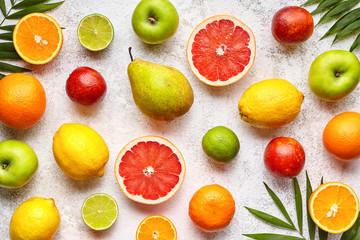 Various citrus fruits background mix flat lay, healthy vegetarian organic food