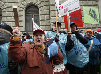 Representatives of Slovenian trade unions stage a protest rally in front of a governmental building in Ljubljana