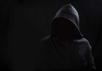 Unknown person concept.Hooded silhouette on black, with no face