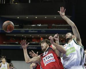 Fotsis of Panathinakos and Jasaitis of Lietuvos Rytas eye a rebound during their Euroleague Top 16 group E game in Vilnius