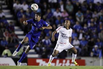 Marcio Passos of Brazil's Corinthians fights for the ball with Jair Pereira of Mexico's Cruz Azul during their Copa Libertadores soccer match in Mexico City