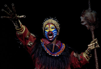 """Actress Brenda Mhlongo dressed as """"Rafiki"""" performs during the press rehearsal of """"El Rey Leon"""" (""""The Lion King"""") musical shows in Madrid"""