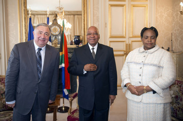 French Senate President Larcher poses with South African president Zuma prior to a meeting at the Luxembourg Palace in Paris