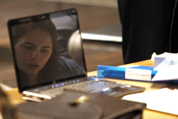 Amanda Knox, the U.S. student convicted of killing her British flatmate Meredith Kercher in Italy on November 2007, is reflected on a laptop's screen during her appeal trial session in Perugia
