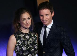 "Eddie Redmayne poses with Hannah Bagshawe as they arrive for the European premiere of the film ""Fantastic Beasts and Where to Find Them"" at Cineworld Imax, Leicester Square in London"