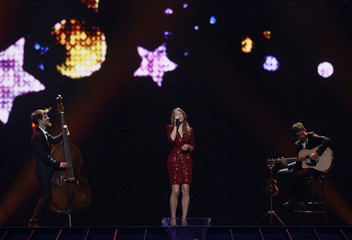 Rossinelli of Switzerland performs her song 'In Love For A While' during the first rehearsal for the finals of the Eurovision Song Contest in Dusseldorf