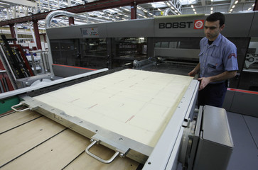 A technician sets up a machine at Bobst demonstration and competence  training center in Mex
