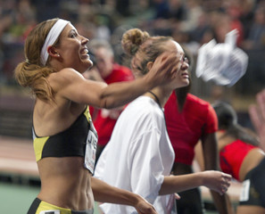 Lolo Jones tosses towel after she won the 50 meter hurdle event  in New York