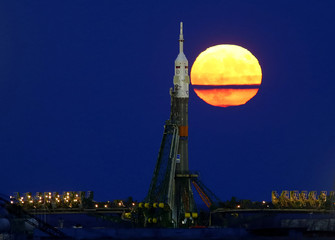 The supermoon rises behind the Soyuz MS-03 spacecraft at the Baikonur cosmodrome in Kazakhstan