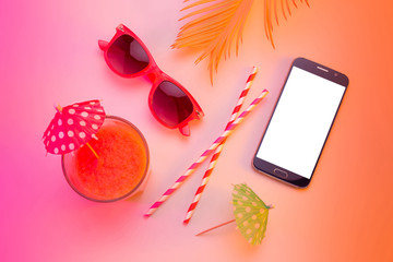 Summer holiday - smartphone, sunglasses and drink