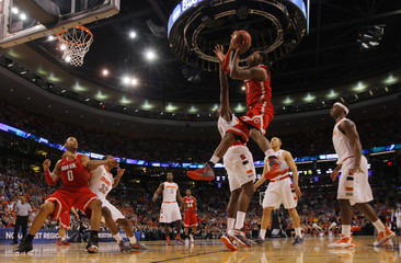 Ohio State Buckeyes' Thomas drives to the net on Syracuse Orange's Christmas during the second half of their men's NCAA East Regional basketball game in Boston