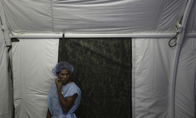 A man from the Yanomamy tribe waits for his surgery at the surgical center at the Cartucho community during a medical expedition in Santa Izabel do Rio Negro