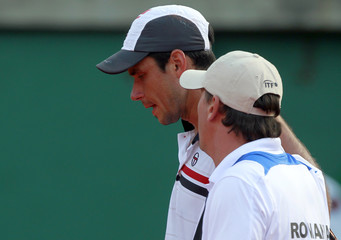 Romania's Hanescu walks off the field with team captain Pavel in Buenos Aires