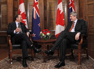 Canada's PM Harper speaks with New Zealand's PM Key during a meeting in Ottawa