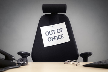 Business chair with out of office sign