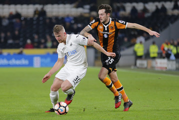 Swansea City's Stephen Kingsley in action with Hull City's Ryan Mason