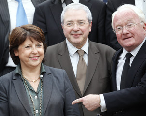 Martine Aubry, France's Socialist Party head, stands with re-elected regional council presidents Huchon and Vauzelle during a family photo at their party headquarters in Paris