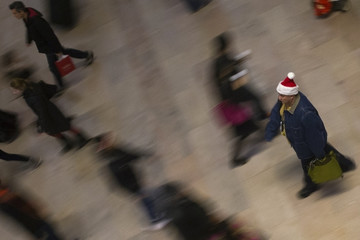 Travelers make their way through the main concourse of Grand Central Terminal on Christmas Eve in New York