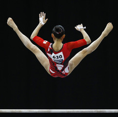 Japan's Shintake competes on the uneven bar at the qualifying round of the Gymnastics World Championships at the Ahoy Arena in Rotterdam
