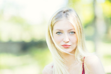 Portrait of young blonde woman with blue eyes.
