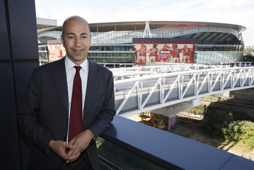Chief Executive Officer of Arsenal Gazidis poses near Emirates Stadium outside his office in London