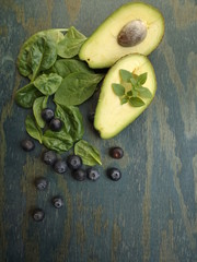 A set of useful foods: spinach, avocados, blueberries and basil