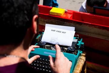writer typing on old typewriter uring sant jordi day in barcelona