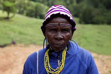 A woman from the Sengwer community poses for a photograph after protesting over their eviction from their ancestral lands, Embobut Forest, by the government for forest conservation in western Kenya