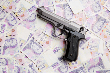 Handgun and money.