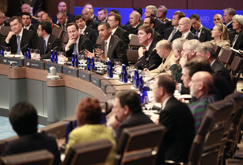 British Prime Minister Cameron and other heads of state and their staffs listen as U.S. President Obama speaks during the opening session of the heads of state meeting on Afghanistan at the NATO Summit in Chicago