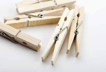 Various wooden clothespin on white background. Isolated..