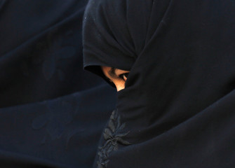An Afghan woman attends an election campaign of Afghan presidential candidate Abdullah Abdullah in Chaghchran capital of Ghor province
