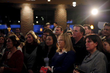 Supporters look on as Republican presidential candidate Sen. Marco Rubio (R-FL) speaks at a campaign rally at Wellman's Pub and Rooftop in West Des Moines, Iowa