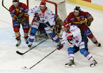 SKA St. Petersburg's Buted comtrols the puck to score the deciding goal during their semi-final ice hockey match at the Spengler Cup tournament in Davos