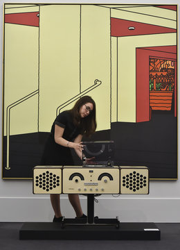 'Radio-Phonograph, Model no RR126' by Pier Giacomo and Achille Castiglioni, is seen in front of 'Foyer' by Patrick Caulfield, part of British pop star David Bowie's art collection, is exhibited during a press view at Sotheby's, in central London
