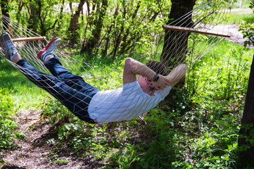 a man lies in a hammock