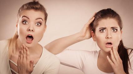 Two shocked and amazed women