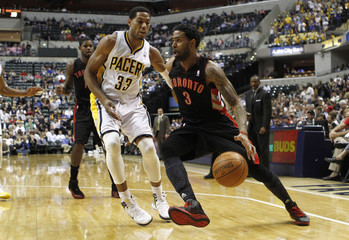 Raptors forward Forbes drives with the basketball defended by Pacers forward Granger during the second quarter of their NBA basketball game in Indianapolis