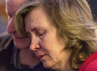A woman cries during a national memorial service for the victims of Malaysia Airlines Flight MH17 at St Patrick's Cathedral in Melbourne,