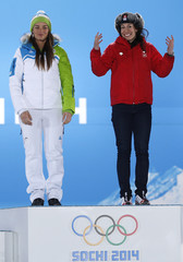 Joint gold medalists Switzerland's Gisin and Slovenia's Maze celebrate during the medal ceremony for the women's alpine skiing downhill race at the Sochi 2014 Winter Olympic Games in Sochi