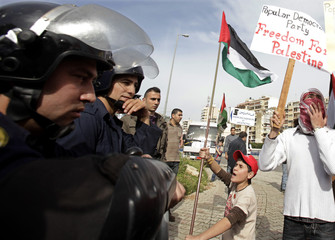 Lebanese and Palestinian leftist groups chant slogans during a demonstration in front of the Egyptian embassy in Beirut
