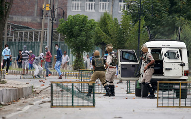 Security personnel clash with stone throwers following the death of Irfan Ahmed in Srinagar