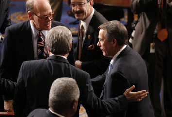 Speaker of the House John Boehner talks with members of Congress at the convening of the 113th Congress in Washington