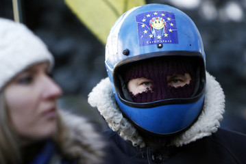 An anti-government protester attends a rally in Kiev