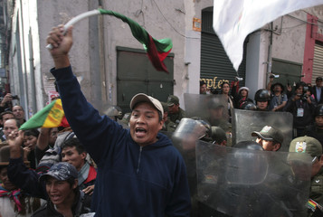 Demonstrators who support Bolivia's Indigenous of Isiboro Secure Territory, known by its Spanish acronym TIPNIS, are seen near square Murillo in La Paz